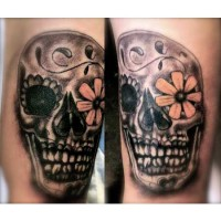 Skull Design Arm Tattoo